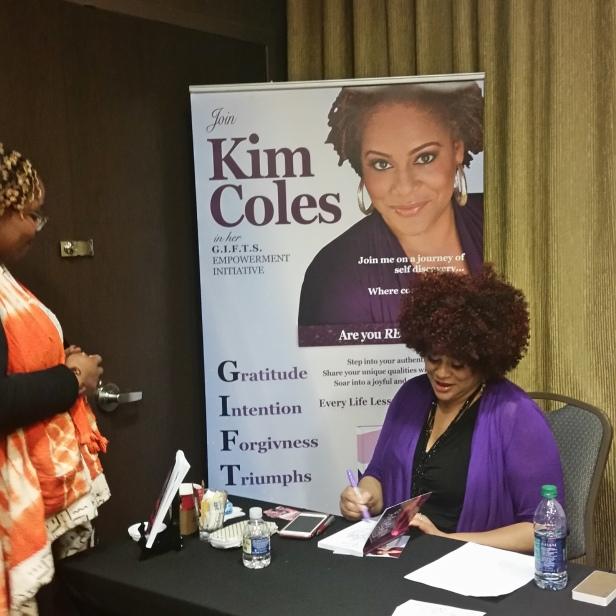 Kim Coles signing books